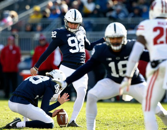Penn State kicker Jake Pinegar (92) kicks a field goal as Blake Gillikin (93) holds the ball during the second half of an NCAA college football game against Wisconsin in State College, Pa., Saturday, Nov. 10, 2018. Penn State won 22-10.