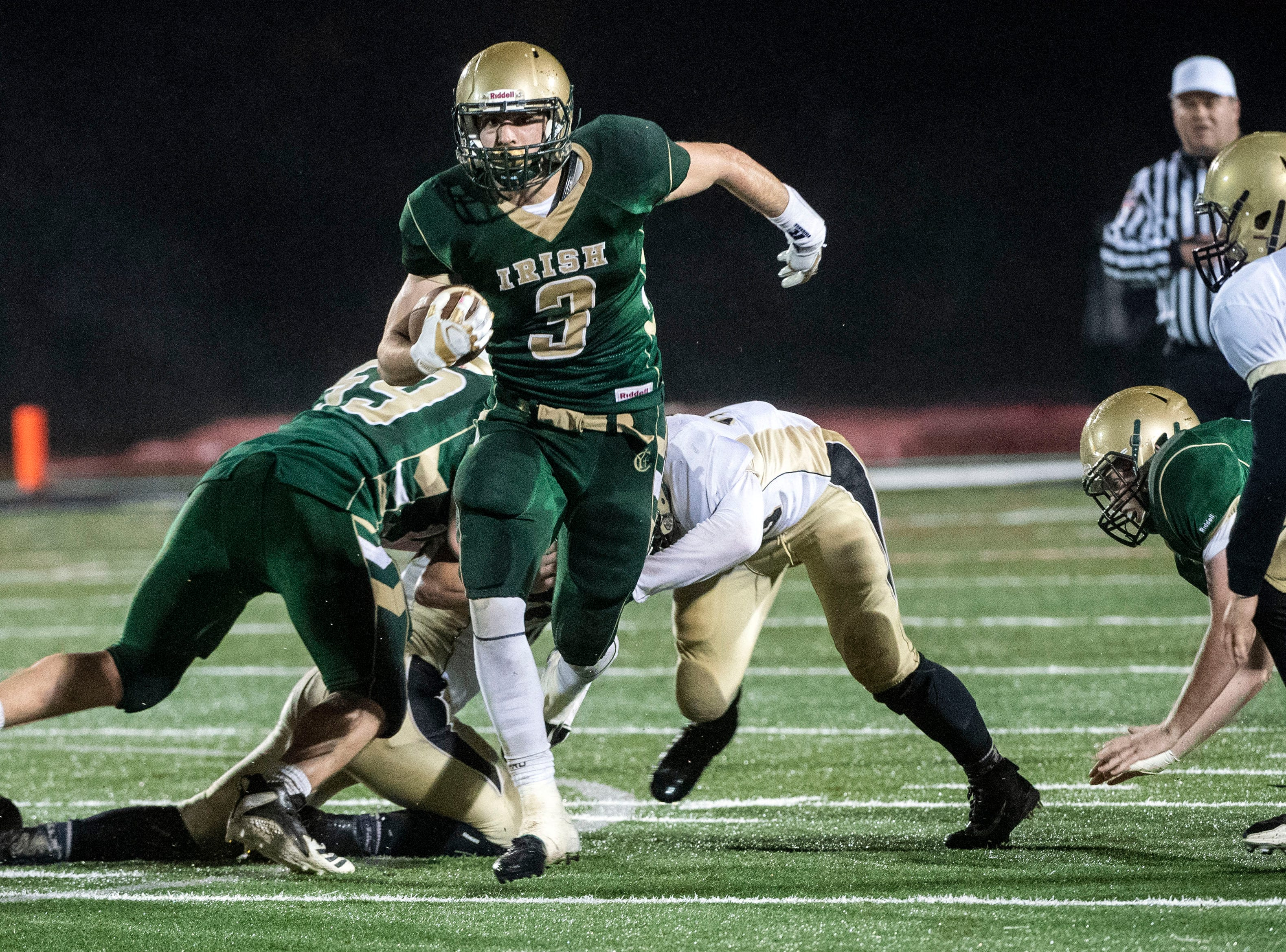 York Catholic's Cole Witman (3) breaks through the offensive line as he runs en route of a touchdown during the District III 2A championship game at South Western High School on Nov. 9, 2018. The York Catholic Fighting Irish beat the Delone Catholic Squires in overtime, 28-21.