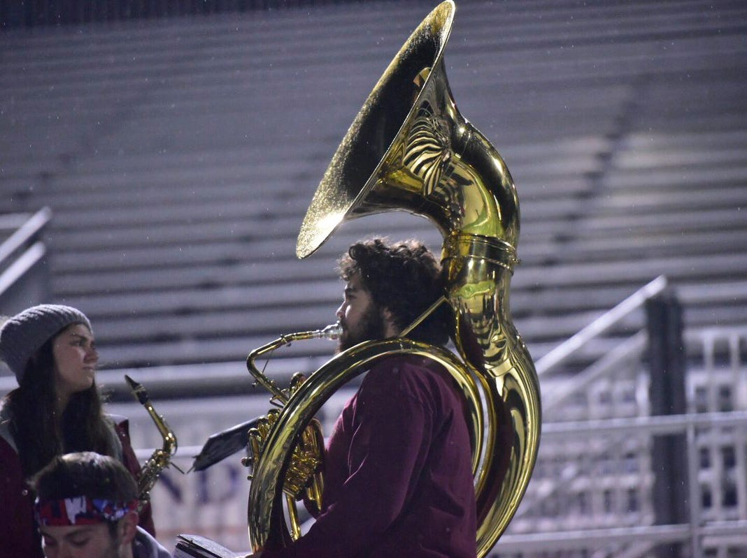 A Shippensburg tuba player plays before Friday night's game against York High.