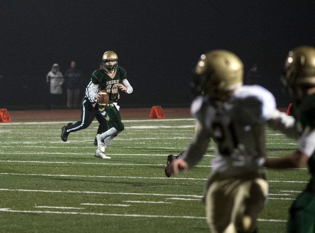 York Catholic's Wesley Burns looks for a receiver against Delone Catholic on Friday night.