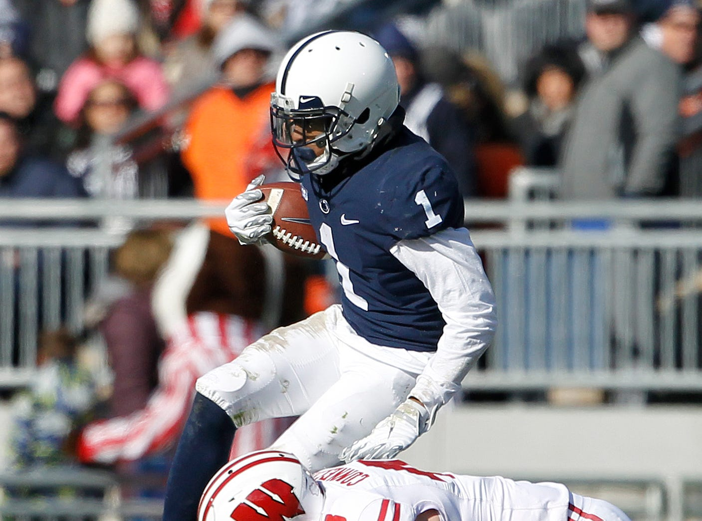 Penn State's KJ Hamler (1) gets hit by Wisconsin's Ryan Connelly (43) after a catch during the first half of an NCAA college football game in State College, Pa., Saturday, Nov. 10, 2018.