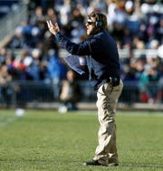 Penn State defensive coordinator Brent Pry motions to his players during a timeout against Wisconsin in the second half of an NCAA college football game in State College, Pa., Saturday, Nov. 10, 2018. Penn State won 22-10.