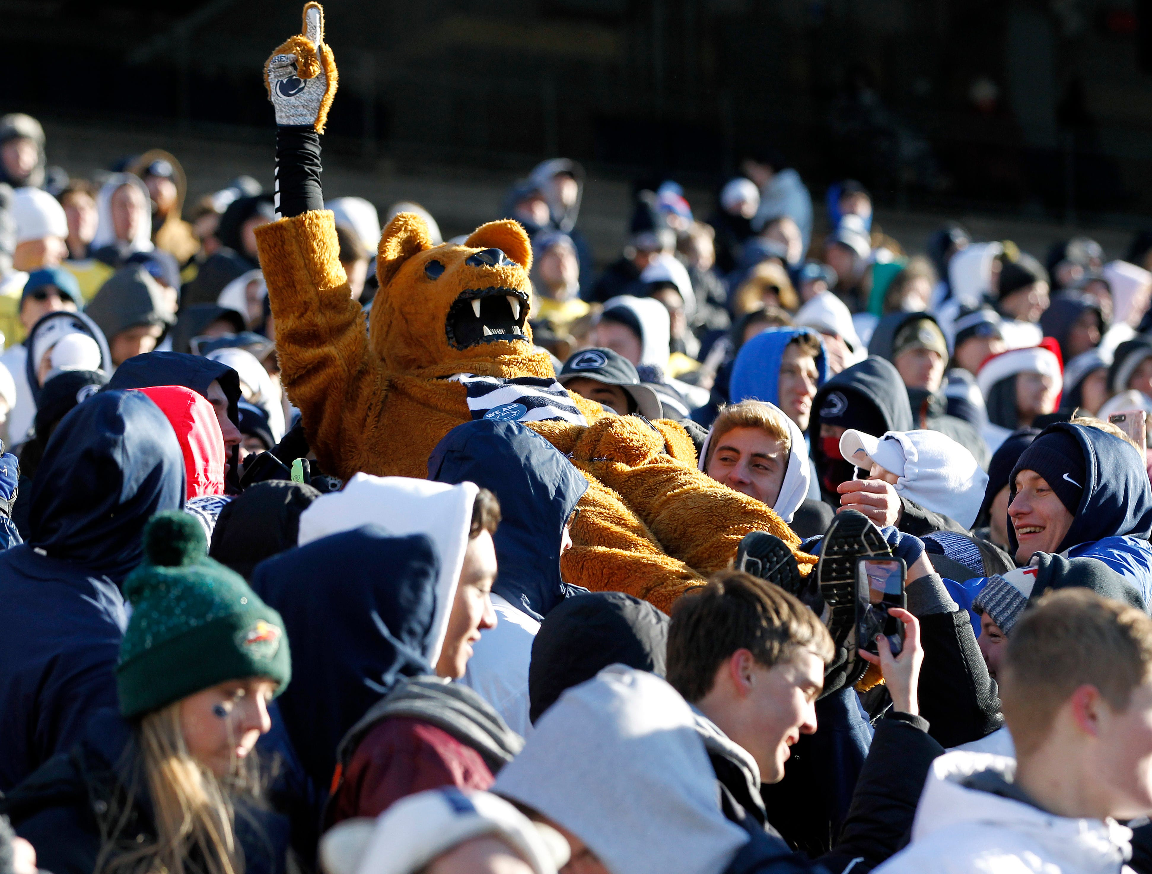 Penn State's Nittany Lion mascot is lifted up by the student section after a field goal against Wisconsin during the second half of an NCAA college football game in State College, Pa., Saturday, Nov. 10, 2018. Penn State won 22-10.