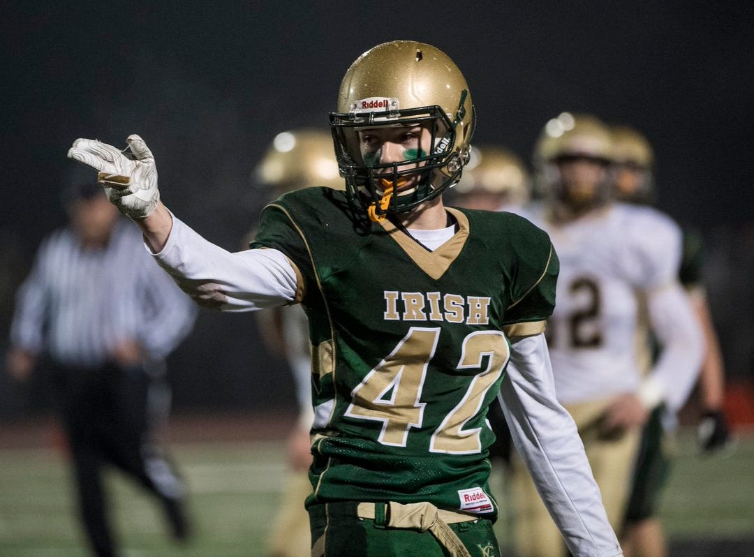 York Catholic's Benjamin Nelson signals a first down Friday in the District 3 Class 2A final.