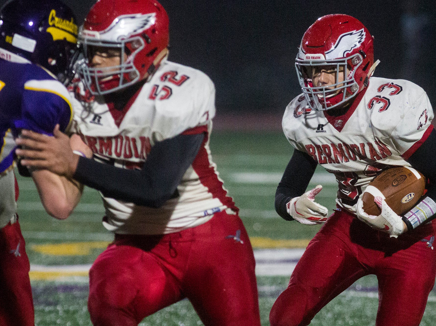 Bermudian Springs' Trace Grim, right, runs with the ball. Bermudian Springs defeats Lancaster Catholic 20-10 in a District 3 Class 3A semifinal football game at Lancaster Catholic's Crusader Stadium, Friday, November 9, 2018.
