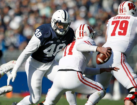 Penn State's Shareef Miller (48) moves in to sack Wisconsin quarterback Jack Coan (17) during the first half of an NCAA college football game in State College, Pa., Saturday, Nov. 10, 2018.