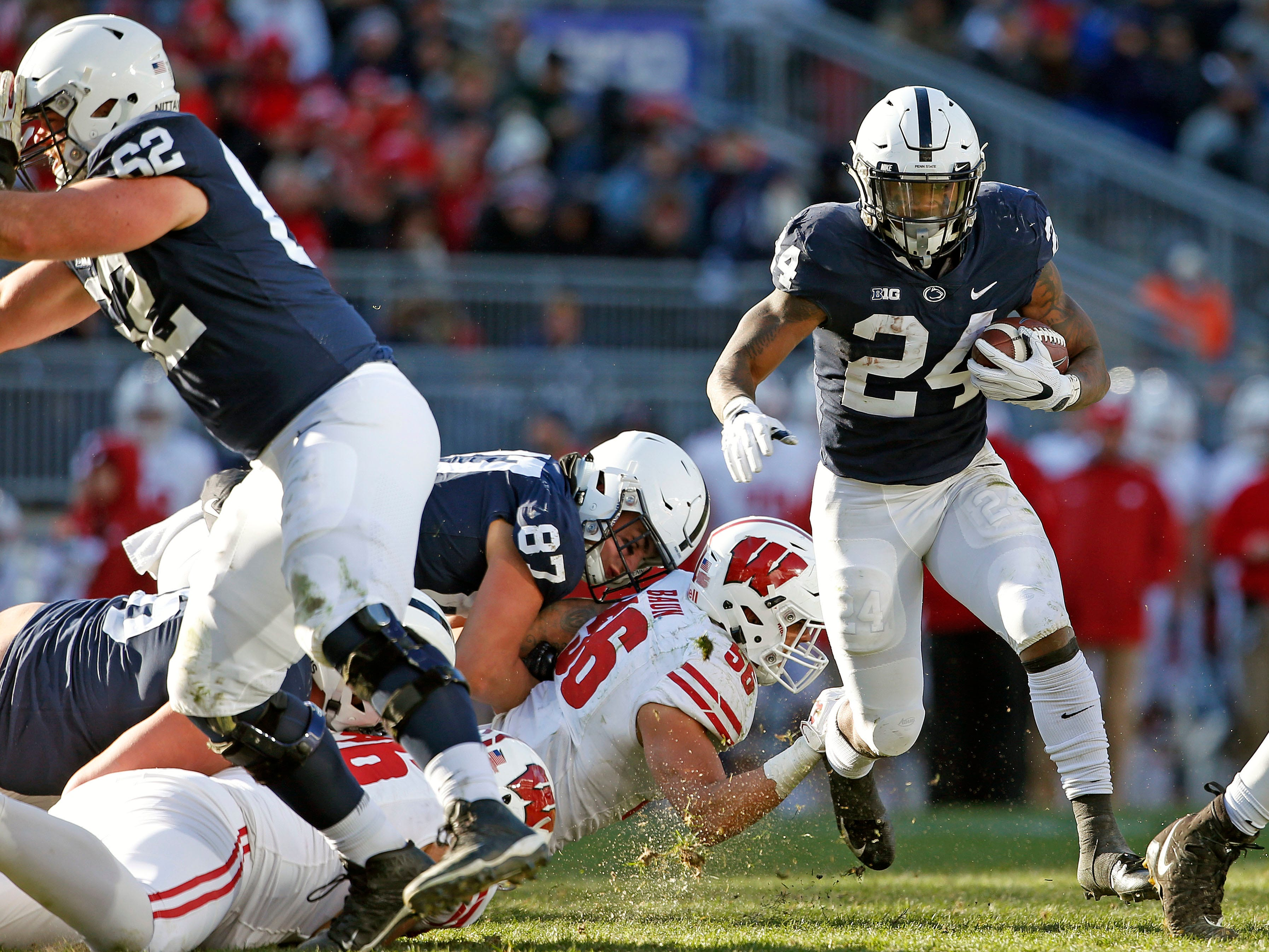 Penn State's Miles Sanders (24) gets past Wisconsin's Zack Baun (56) during the second half of an NCAA college football game in State College, Pa., Saturday, Nov. 10, 2018. Penn State won 22-10.