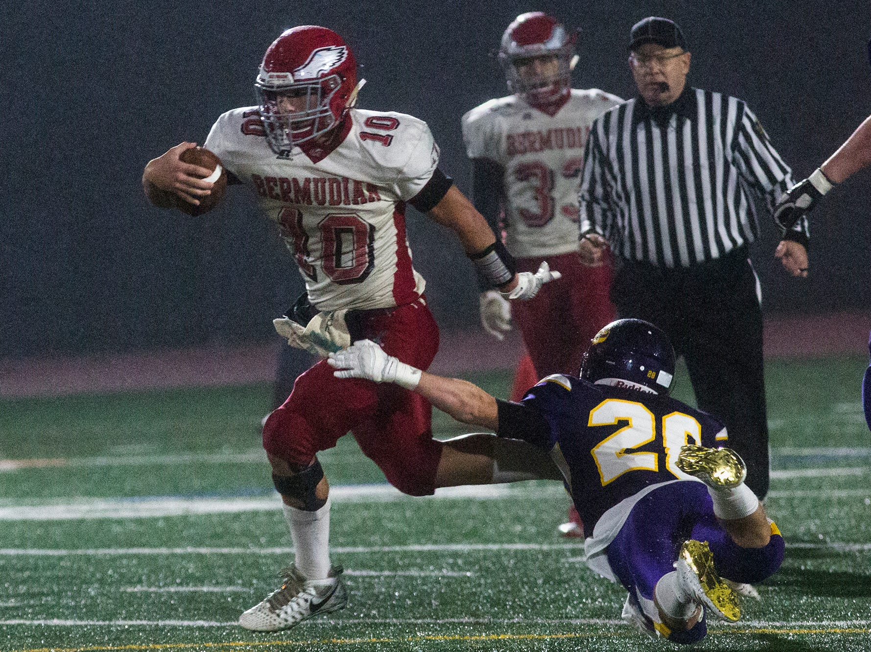 Bermudian Springs quarterback Chase Dull, left, breaks a long run for the Eagles' third touchdown. Bermudian Springs defeats Lancaster Catholic 20-10 in a District 3 Class 3A semifinal football game at Lancaster Catholic's Crusader Stadium, Friday, November 9, 2018.