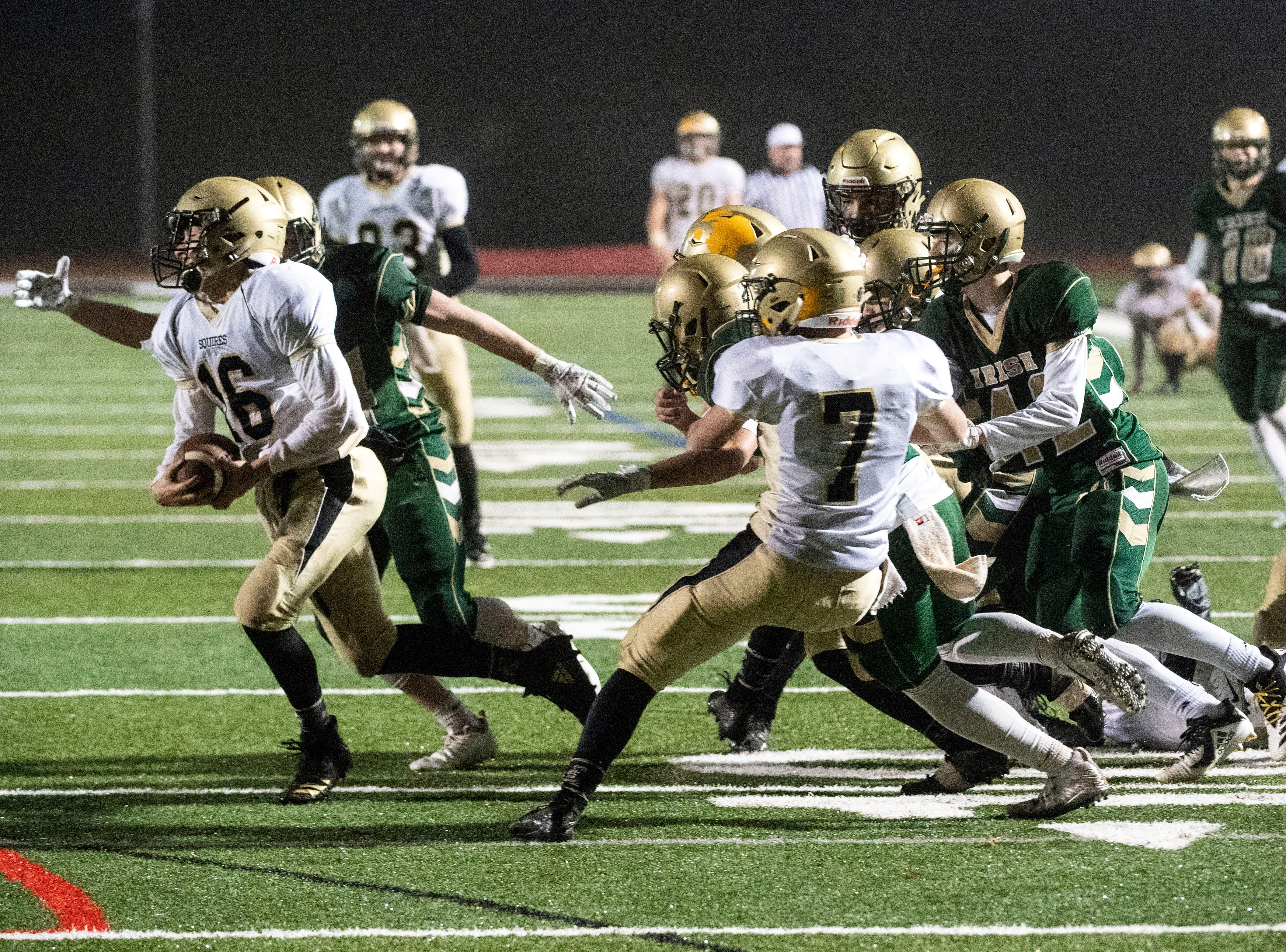 Delone Catholic's Evan Brady (16) runs across the field after coming up with an interception during the District III 2A championship game at South Western High School on Nov. 9, 2018. The York Catholic Fighting Irish beat the Delone Catholic Squires in overtime, 28-21.