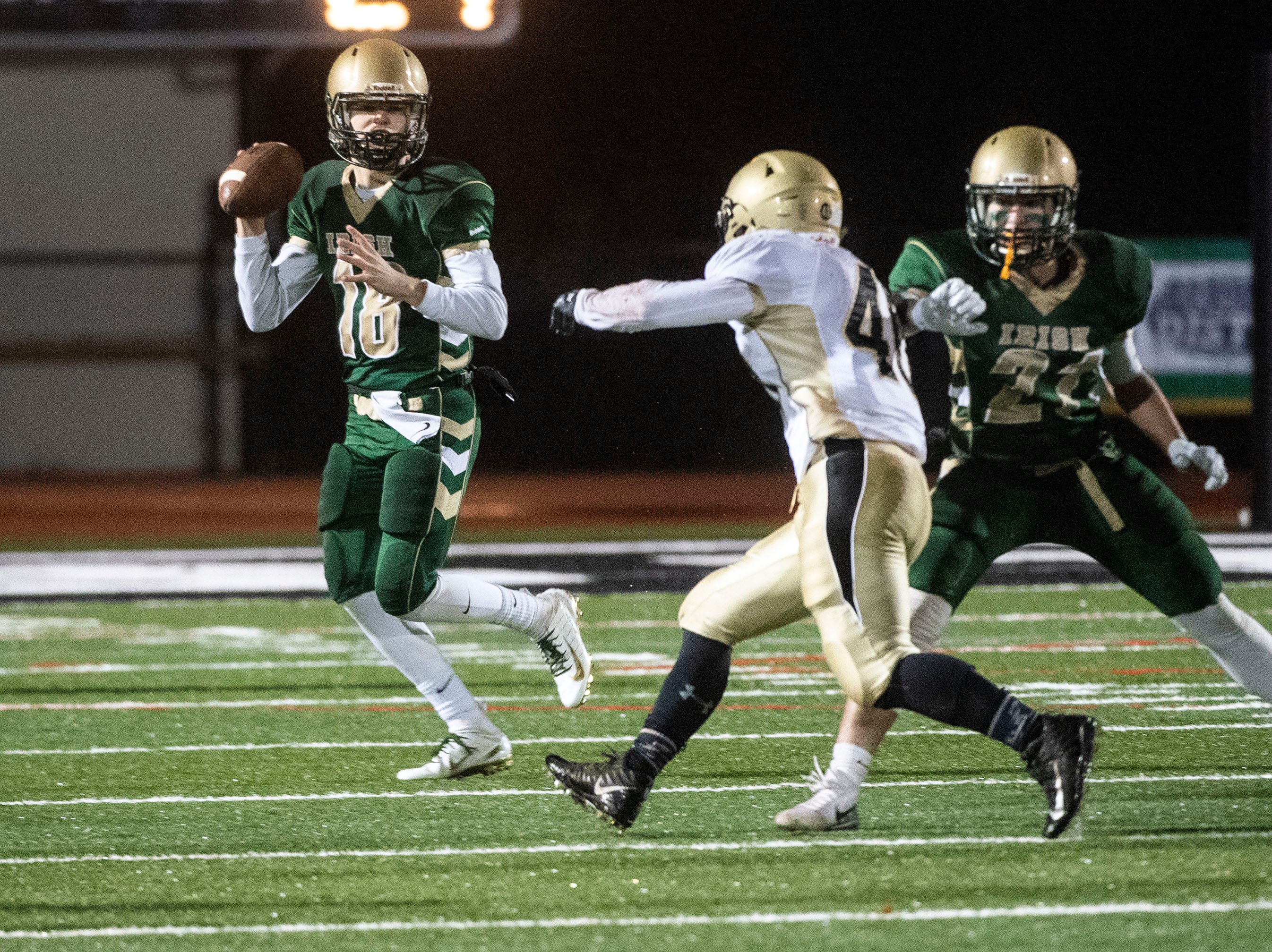 York Catholic quarterback Wesley Burns (18) looks for a pass during the District III 2A championship game at South Western High School on Nov. 9, 2018. The York Catholic Fighting Irish beat the Delone Catholic Squires in overtime, 28-21.