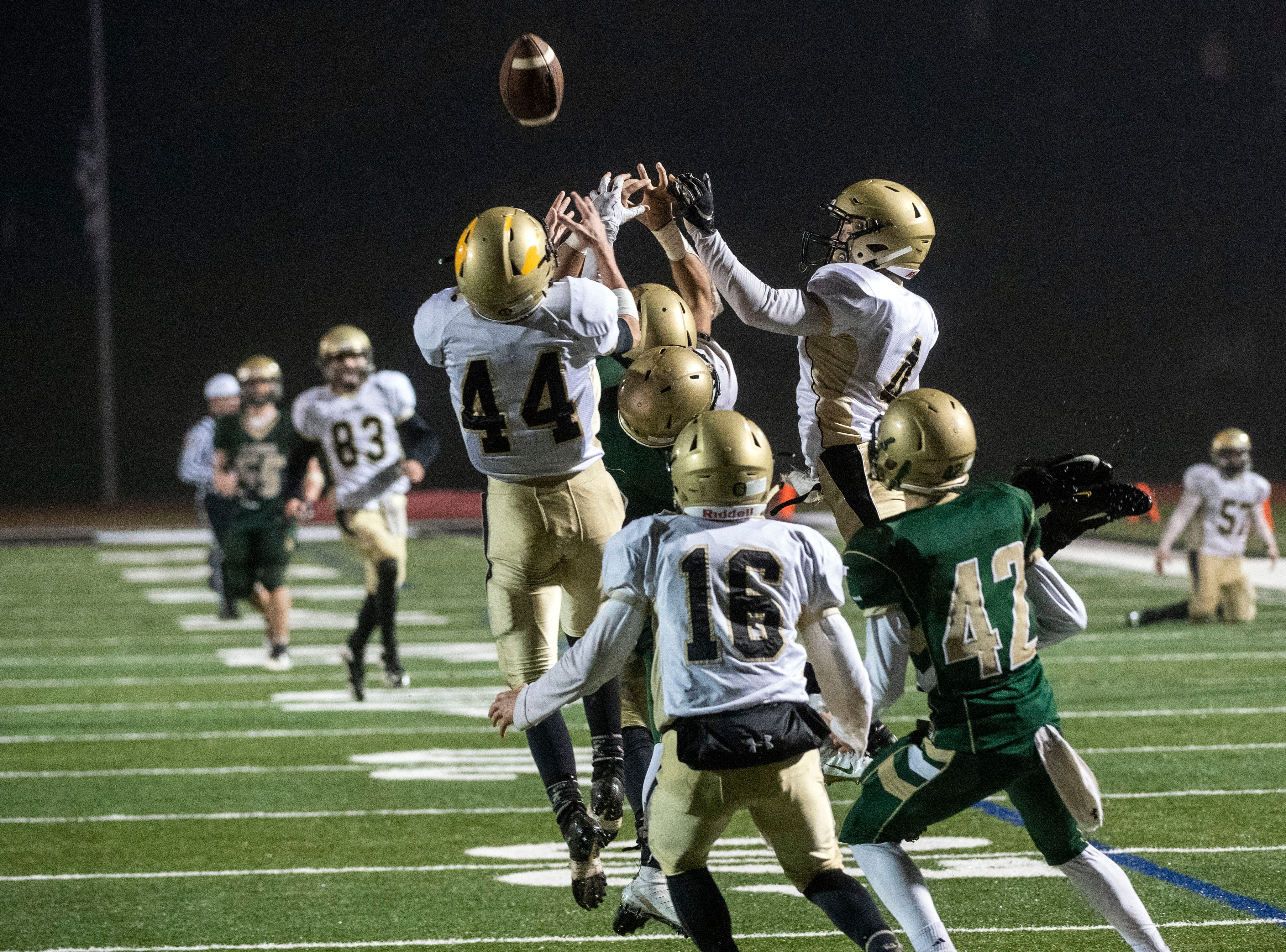 Delone and York Catholic players leap into the air for a York Catholic Hail Mary pass during the District III 2A championship game at South Western High School on Nov. 9, 2018. The York Catholic Fighting Irish beat the Delone Catholic Squires in overtime, 28-21.