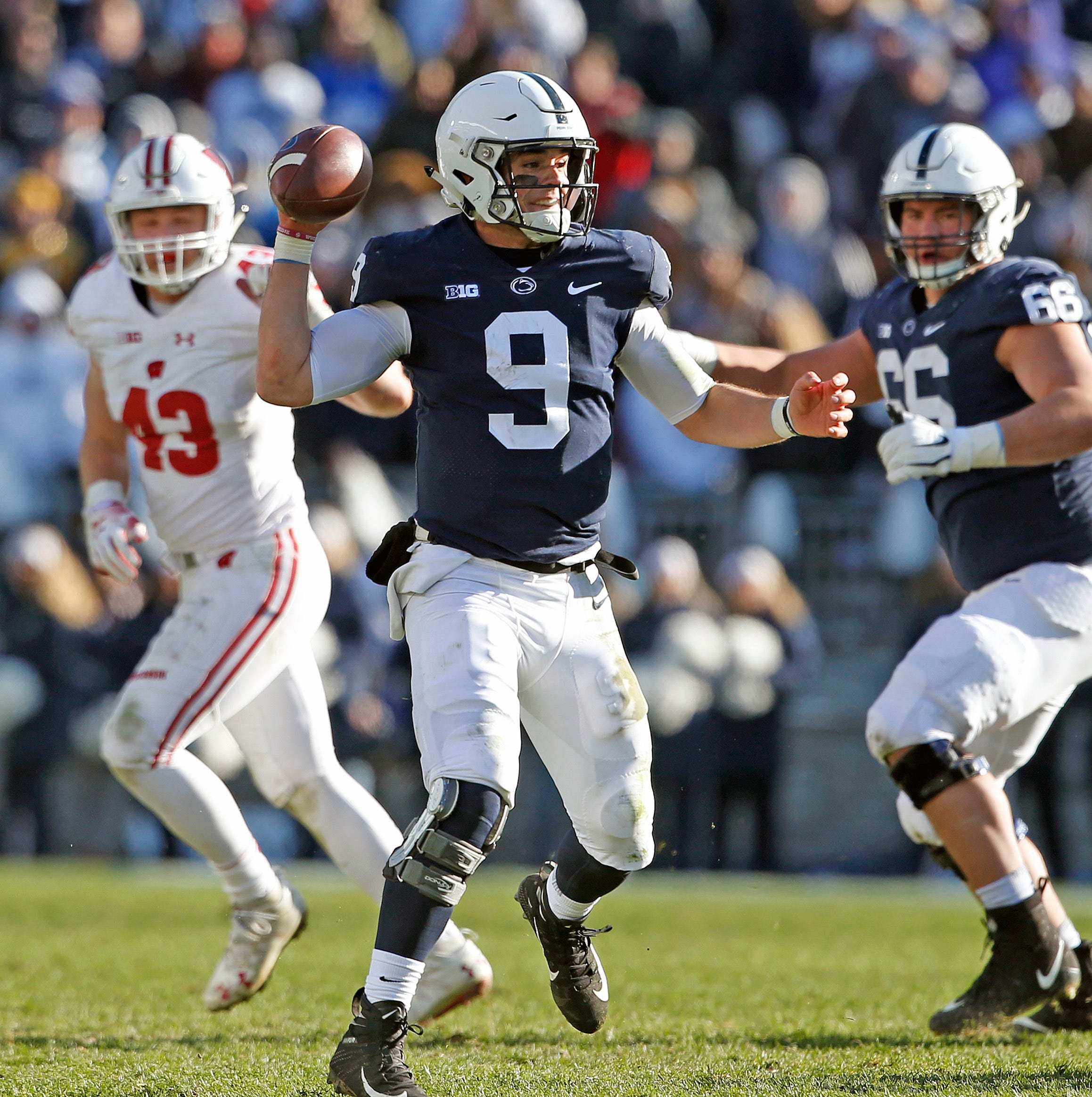 Penn State quarterback Trace McSorley (9) looks to pass the ball against as he is pressured out of the pocket against Wisconsin during the second half of an NCAA college football game in State College, Pa., Saturday, Nov. 10, 2018. Penn State won 22-10.