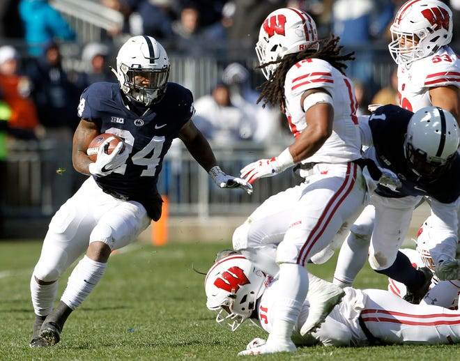 Penn State's Miles Sanders (24) runs the ball against Wisconsin during the first half of an NCAA college football game in State College, Pa., Saturday, Nov. 10, 2018.