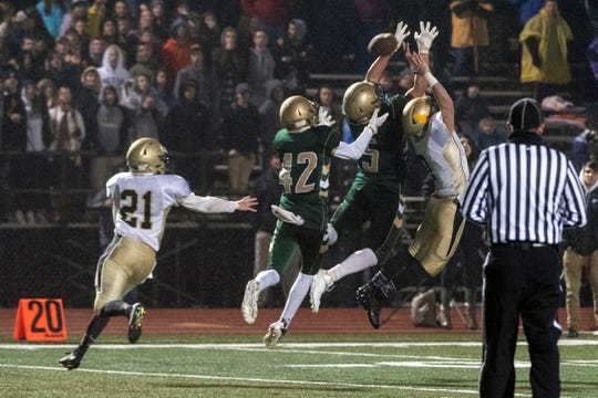 York Catholic's Isaiah Pineda (5) and Benjamin Nelson (42) got for a pass during the District III 2A championship game at South Western High School on Nov. 9, 2018. The York Catholic Fighting Irish beat the Delone Catholic Squires in overtime, 28-21.