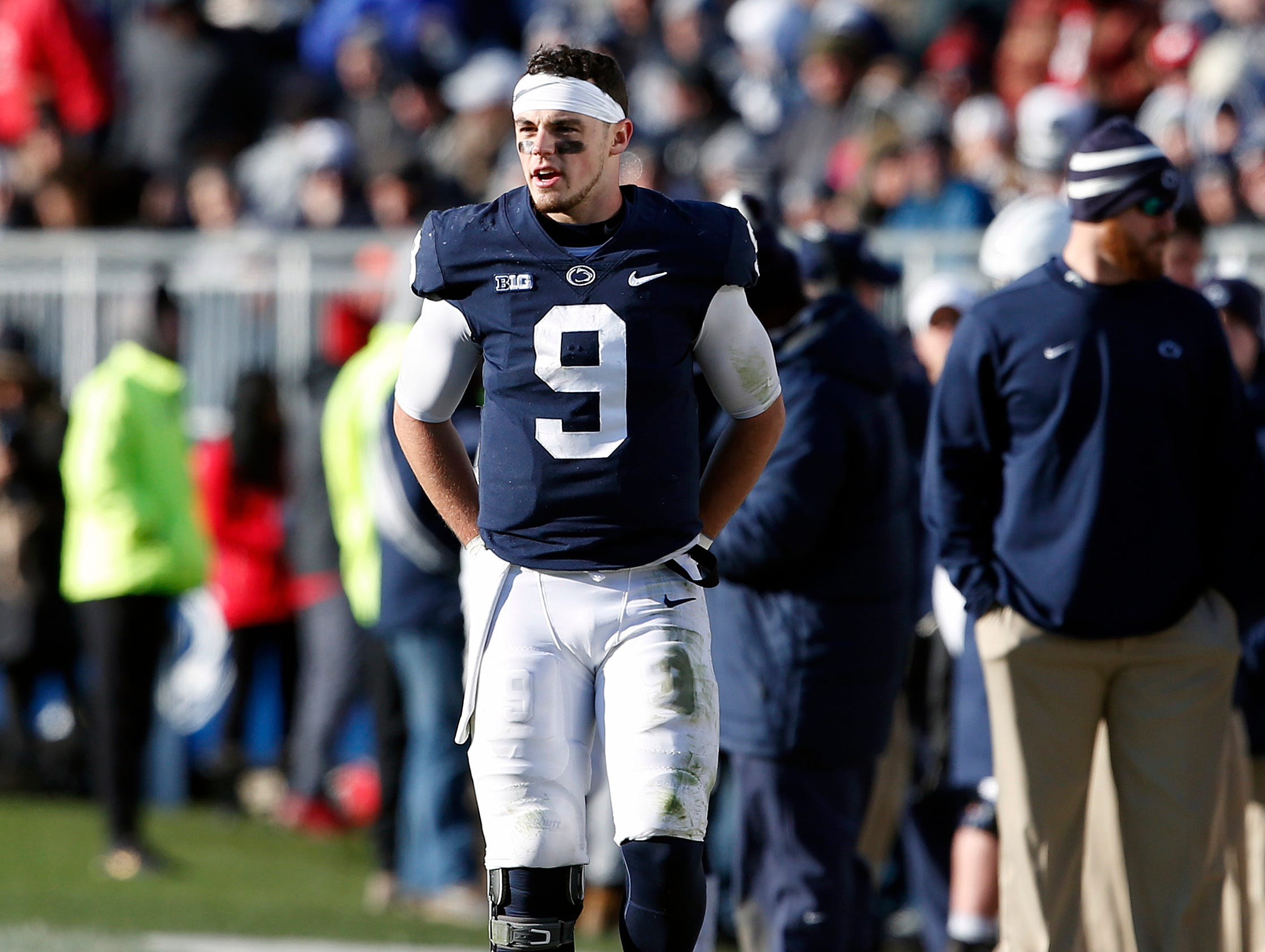 Penn State quarterback Trace McSorley (9) walks the sidelines during a timeout against Wisconsin in the second half of an NCAA college football game in State College, Pa., Saturday, Nov. 10, 2018. Penn State won 22-10.