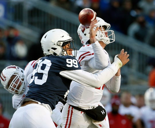 Penn State's Yetur Gross-Matos (99) knocks the ball out of the hand of Wisconsin quarterback Jack Coan (17) during the second half of an NCAA college football game in State College, Pa., Saturday, Nov. 10, 2018. Penn State won 22-10.