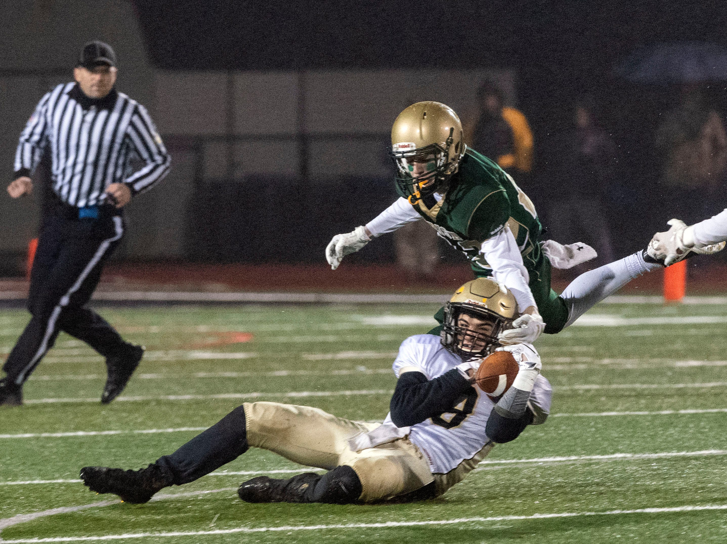 Delone Catholic's Marcello Malvone (8) pulls down a pass during the District III 2A championship game at South Western High School on Nov. 9, 2018. The York Catholic Fighting Irish beat the Delone Catholic Squires in overtime, 28-21.