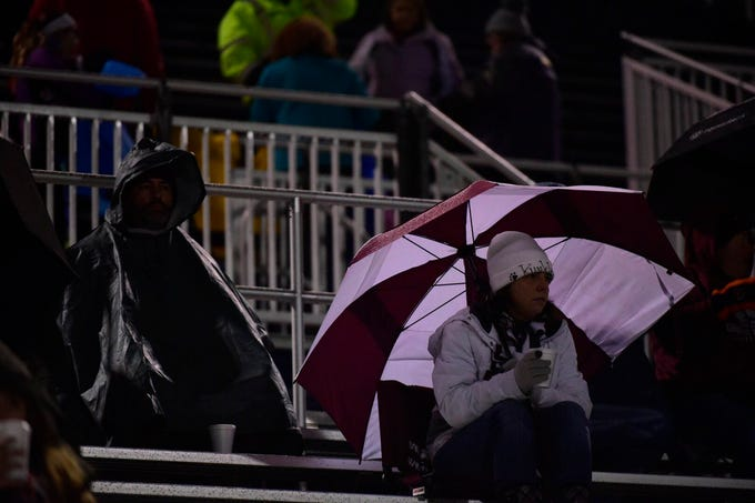 A hot beverage, warm clothes and rain gear were required at Friday's game in Chambersburg.