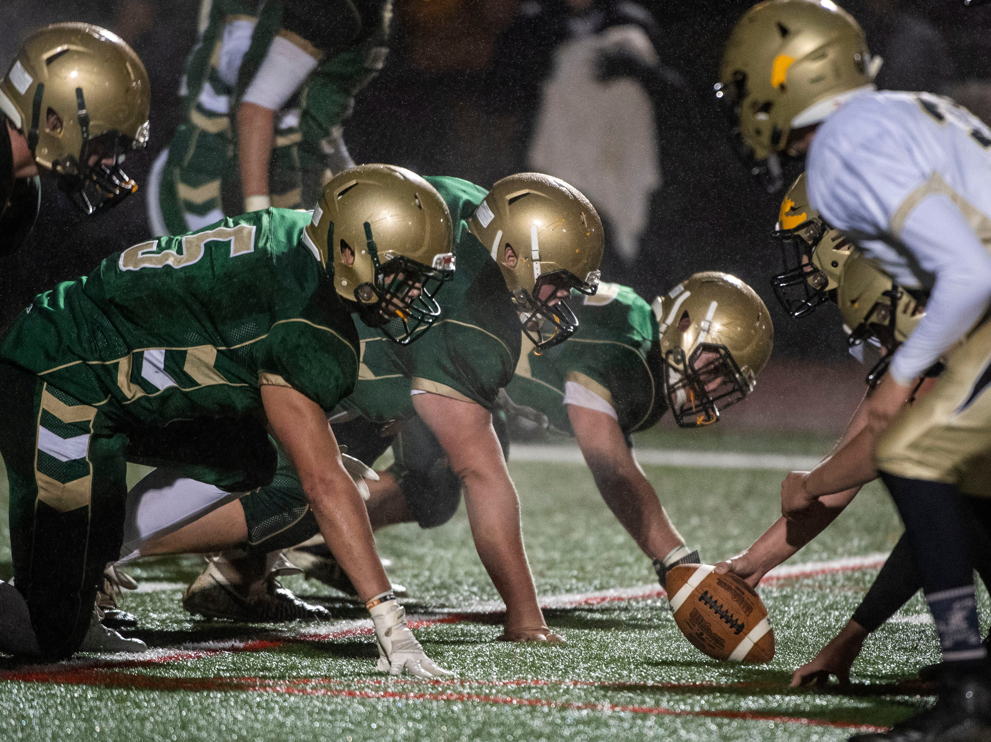 The York Catholic defensive line gets set on the ball during the District III 2A championship game at South Western High School on Nov. 9, 2018. The York Catholic Fighting Irish beat the Delone Catholic Squires in overtime, 28-21.