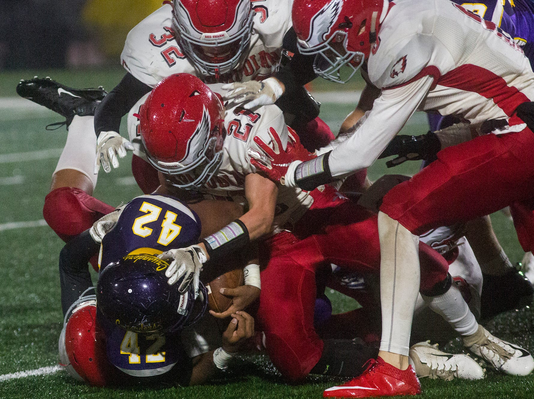 Members of the Bermudian Springs defense tackle Lancaster Catholic's Alex Cruz. Bermudian Springs defeats Lancaster Catholic 20-10 in a District 3 Class 3A semifinal football game at Lancaster Catholic's Crusader Stadium, Friday, November 9, 2018.