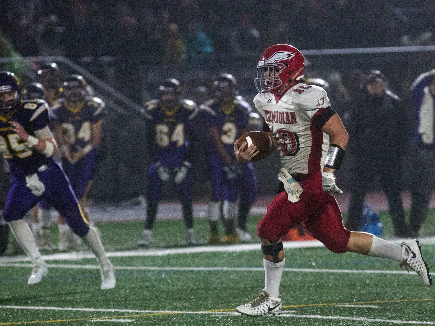 Bermudian Springs quarterback Chase Dull, right, breaks a long run for the Eagles' third touchdown. Bermudian Springs defeats Lancaster Catholic 20-10 in a District 3 Class 3A semifinal football game at Lancaster Catholic's Crusader Stadium, Friday, November 9, 2018.