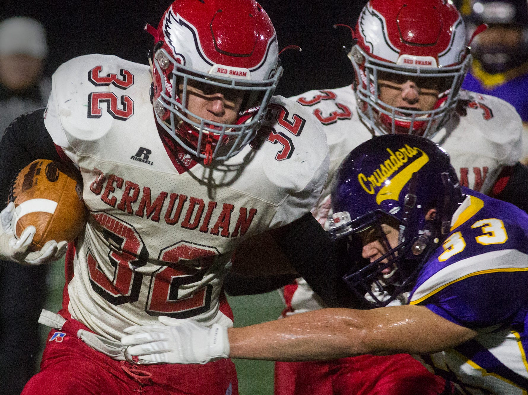 Bermudian Springs' Thomas Bross, left, runs with the ball. Bermudian Springs defeats Lancaster Catholic 20-10 in a District 3 Class 3A semifinal football game at Lancaster Catholic's Crusader Stadium, Friday, November 9, 2018.