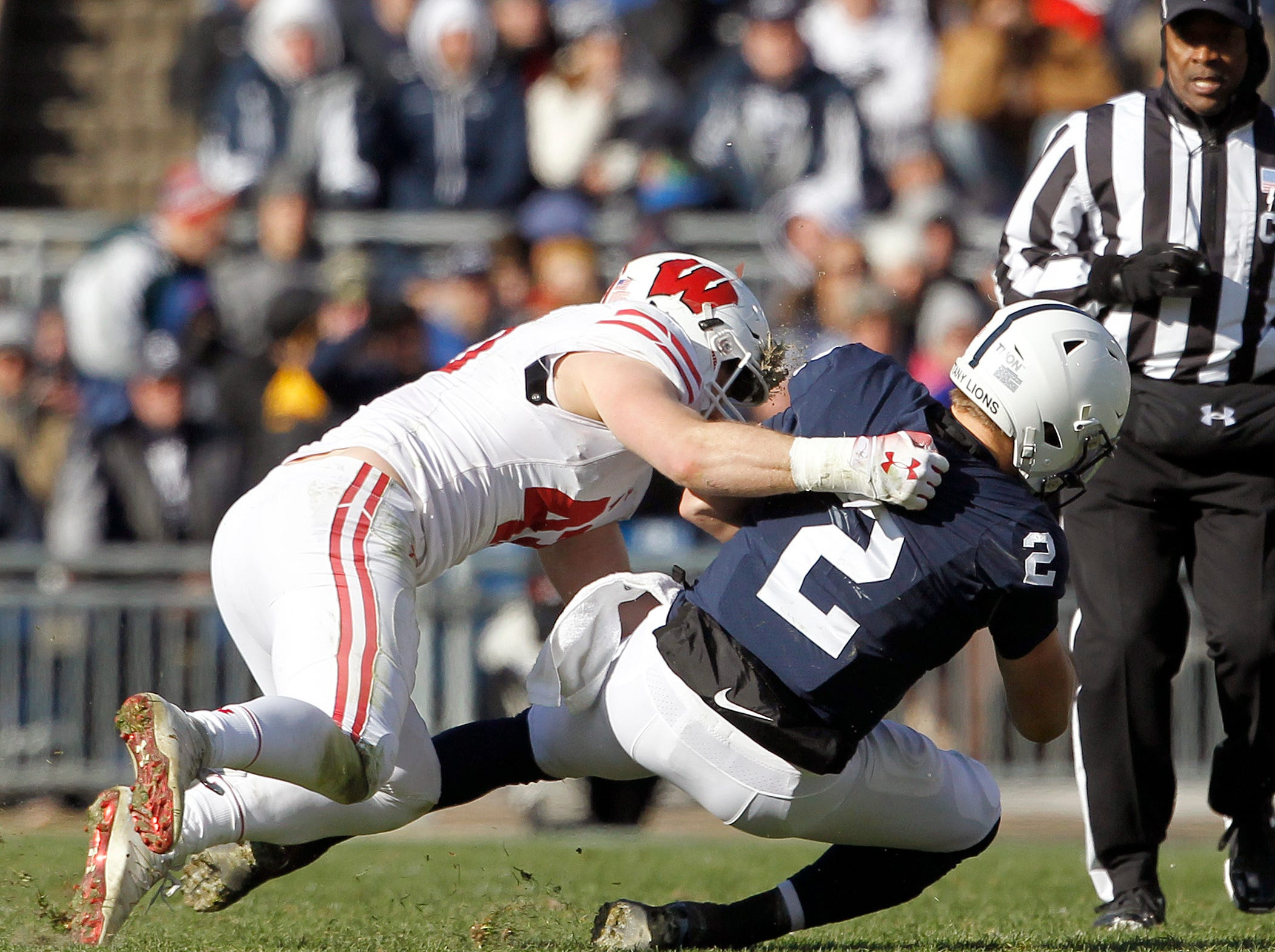 Penn State quarterback Tommy Stevens (2) is sacked by Wisconsin Jack Connelly (43) during the first half of an NCAA college football game in State College, Pa., Saturday, Nov. 10, 2018.