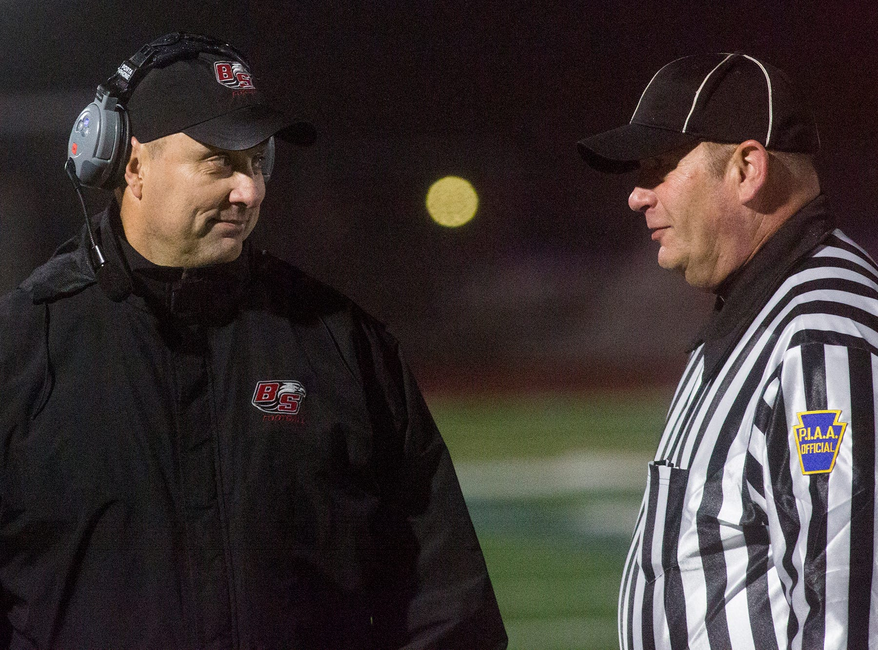 Bermudian Springs head coach Jon DeFoe, left, speaks with an official during the game. Bermudian Springs defeats Lancaster Catholic 20-10 in a District 3 Class 3A semifinal football game at Lancaster Catholic's Crusader Stadium, Friday, November 9, 2018.
