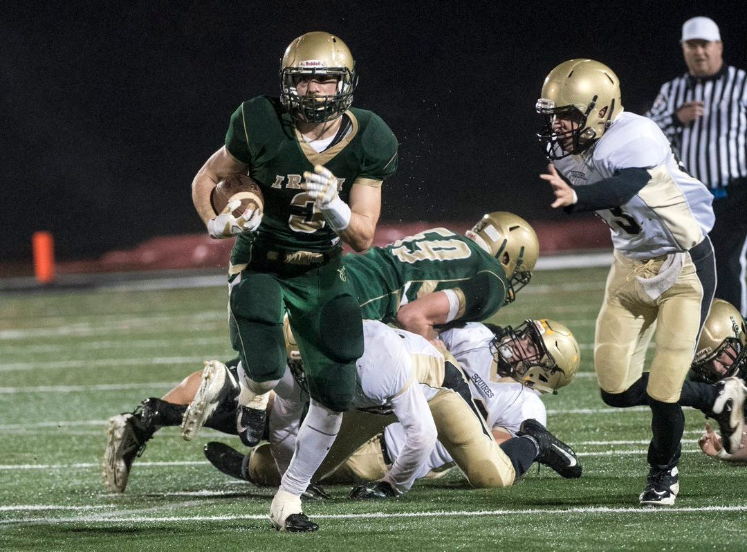 Cole Witman takes off with the ball for a York Catholic gain Friday night.