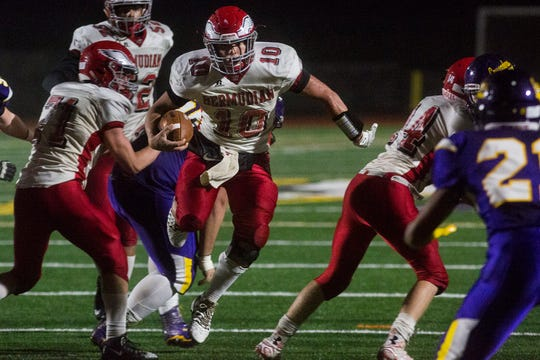 Bermudian Springs quarterback Chase Dull, center, runs the ball. Bermudian Springs defeats Lancaster Catholic 20-10 in a District 3 Class 3A semifinal football game at Lancaster Catholic's Crusader Stadium, Friday, November 9, 2018.