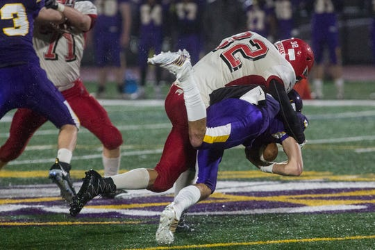 Bermudian Springs' Thomas Bross, top right, sacks Lancaster Catholic quarterback Gavin Sullivan. Bermudian Springs defeats Lancaster Catholic 20-10 in a District 3 Class 3A semifinal football game at Lancaster Catholic's Crusader Stadium, Friday, November 9, 2018.