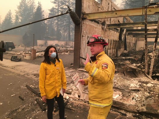 CalFire PIO Robert Foxworthy describes the damage in the main business district of Paradise, Calif., on Nov. 10, 2018. The fire burned 90,000 acres in little more than a day and became the worst fire in California history in terms of structures lost.