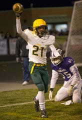 Manogue's Dontell Jackson (21) celebrates after make an interception in the end zone on Friday night at Spanish Springs High School in Sparks.