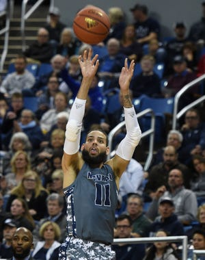 Nevada's Cody Martin goes up for a 3-pointer against Pacific. The Wolf Pack made 15 shots from behind the arc on Friday.