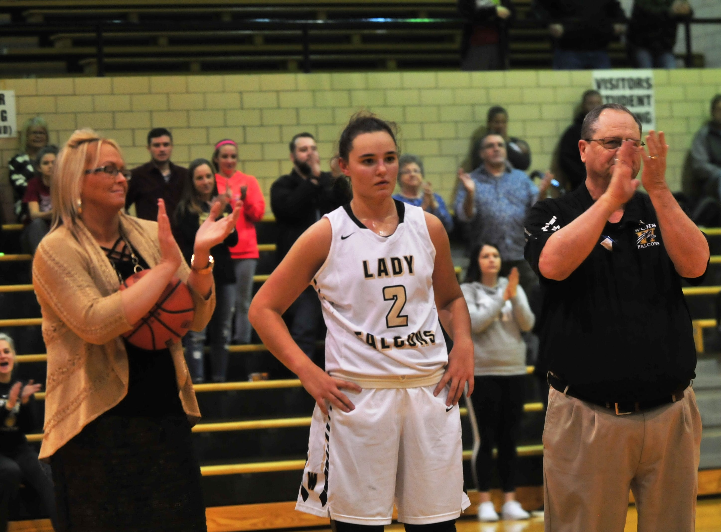 Winchester's Maddie Lawrence (2) was honored for surpassing the 1,000-point milestone during halftime of an 84-44 girls basketball win over Knightstown Friday, Nov. 9, 2018 at Winchester Fieldhouse.