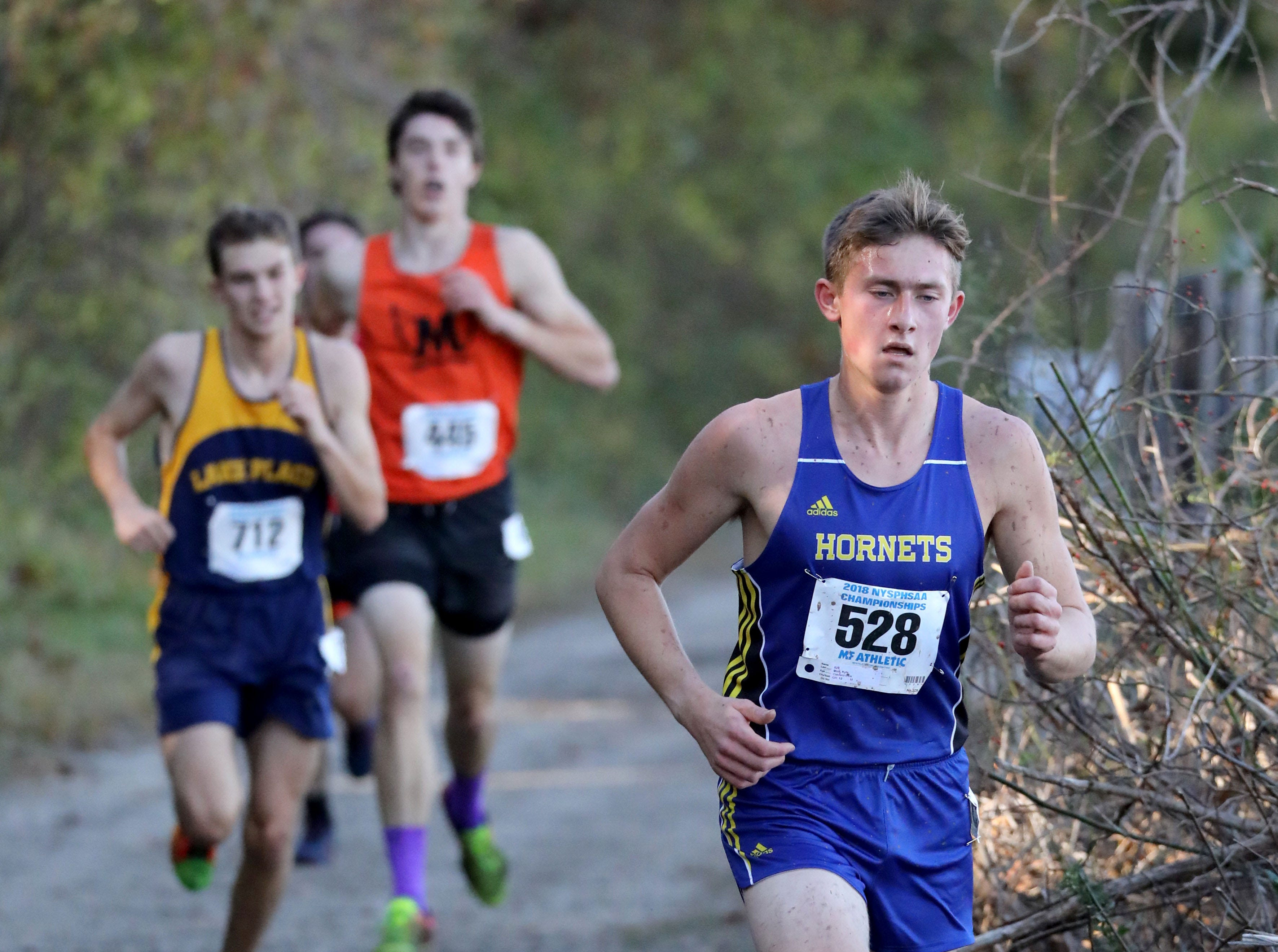 Kyle Mott from Oakfield-Elba, runs the boys Class D race during the 2018 NYSPHSAA Cross Country Championships at Sunken Meadow State Park in Kings Park on Nov. 10, 2018.