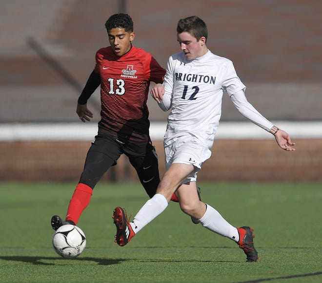 Brighton's Connor McQuillan, right, clears the ball past Amityville's Rolman Guardado during a Class A semifinal at the NYSPHSAA Boys Soccer Championships in Newburgh, N.Y., Saturday, Nov. 10, 2018.