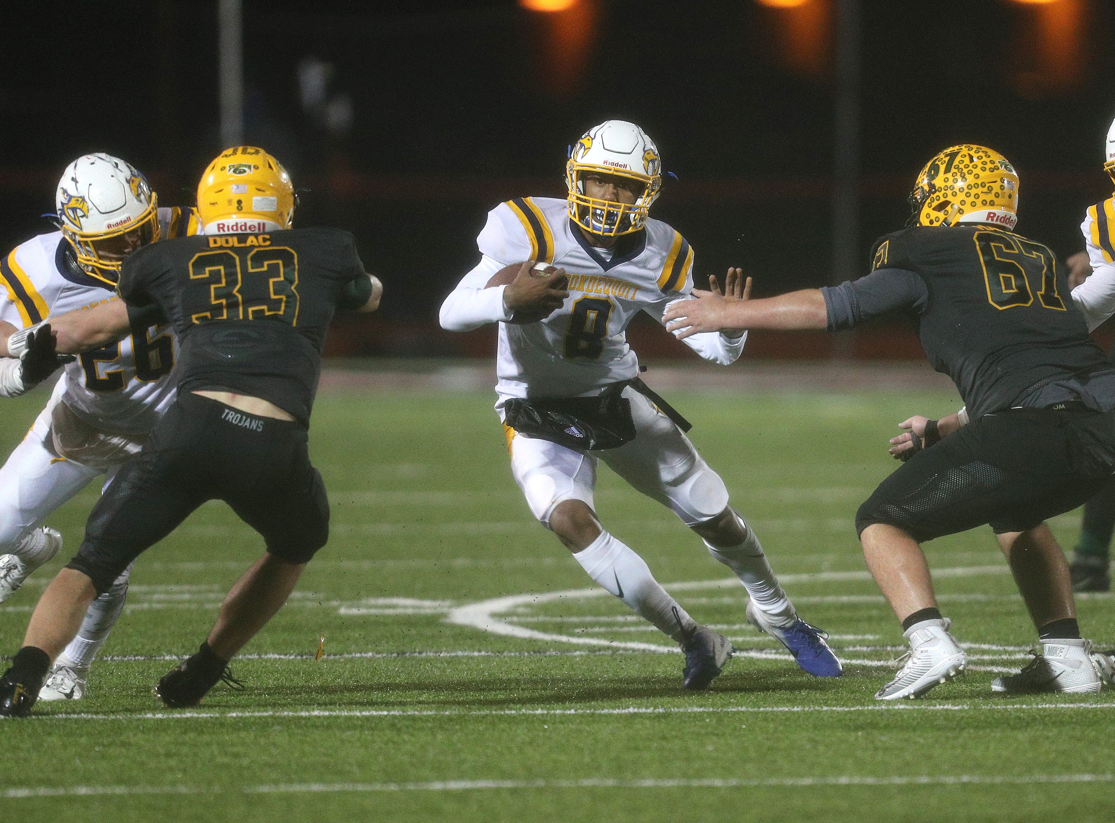 Irondequoit's Freddy June Jr. cuts back to find running room against West Seneca East.