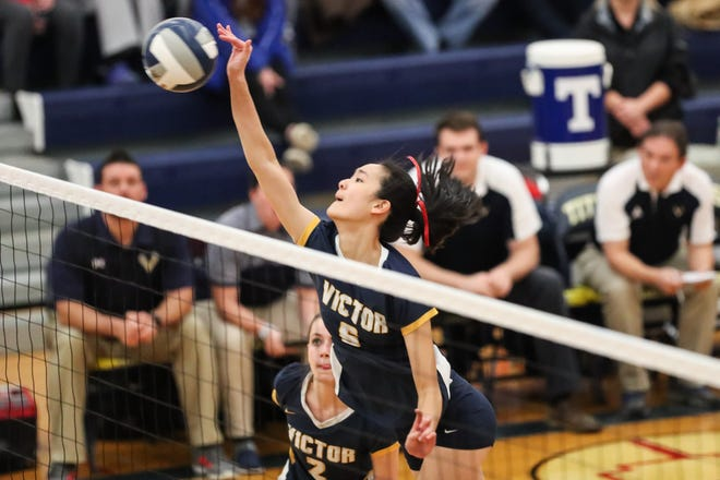 Victor's Helen Qian (6) spikes the ball against Orchard Park during the Far West Regionals on Nov. 9, 2018.