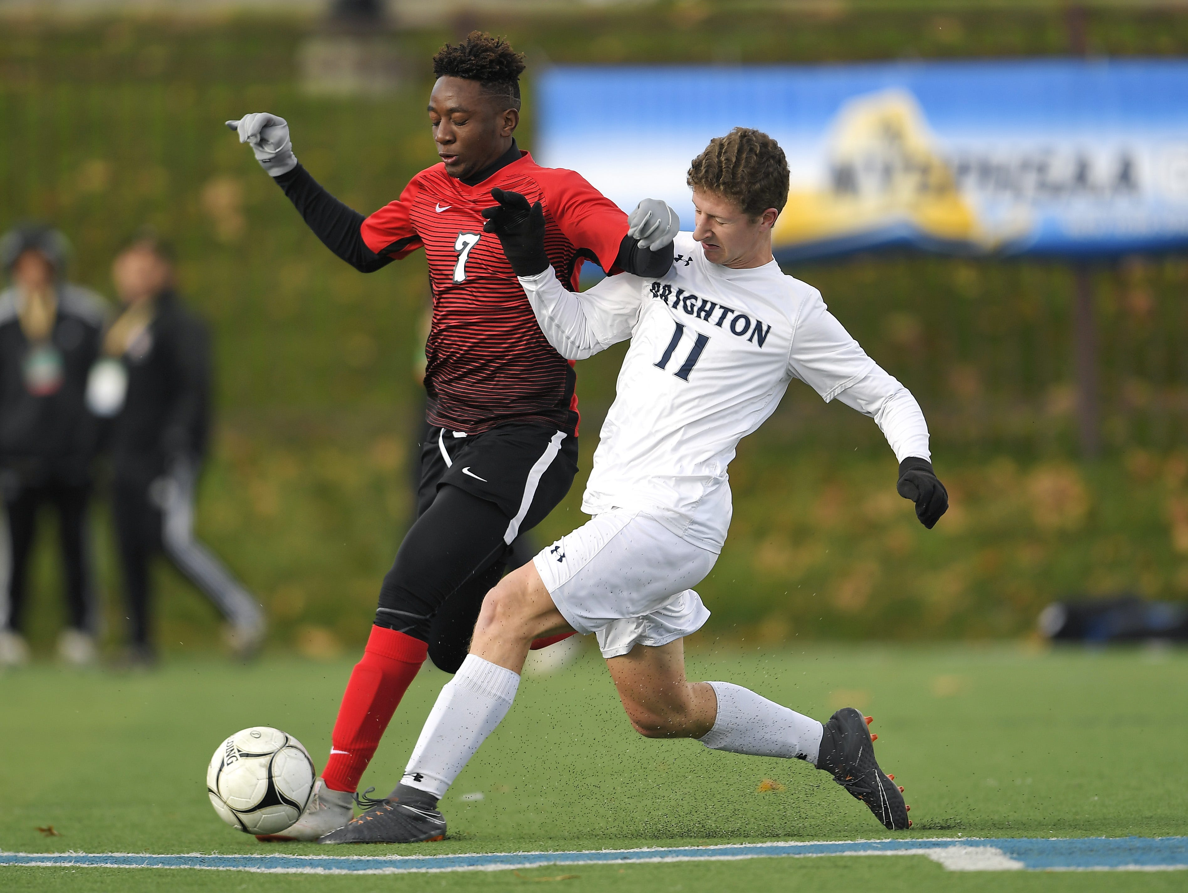 Brighton's Sam O'Connor, right, challenges for the ball against Amityville's Kymani Hines during a Class A semifinal at the NYSPHSAA Boys Soccer Championships in Newburgh, N.Y., Saturday, Nov. 10, 2018.