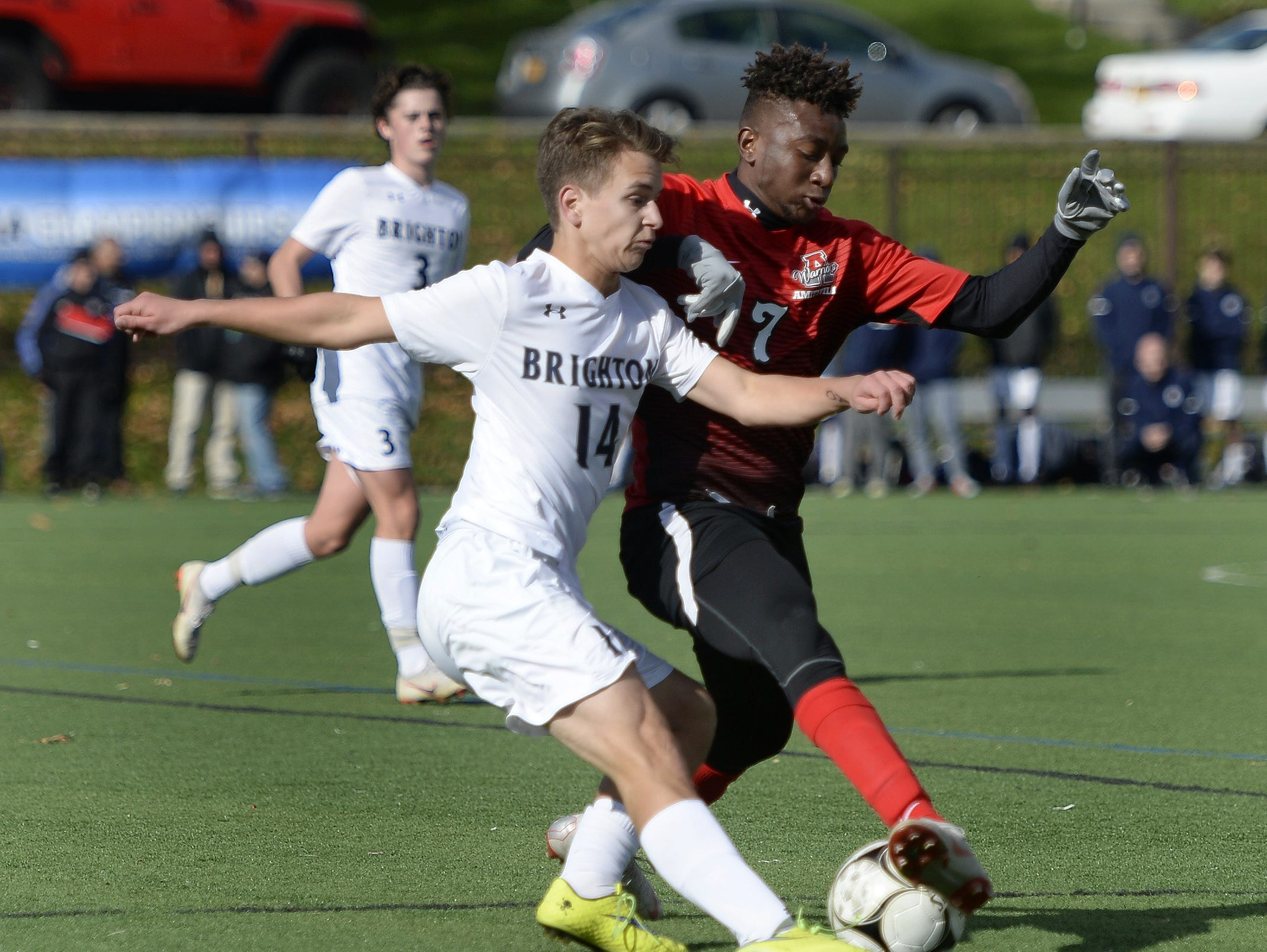 Brighton's Roman Storozynsky, left, clears the ball past Amityville's Kymani Hines during a Class A semifinal at the NYSPHSAA Boys Soccer Championships in Newburgh, N.Y., Saturday, Nov. 10, 2018.