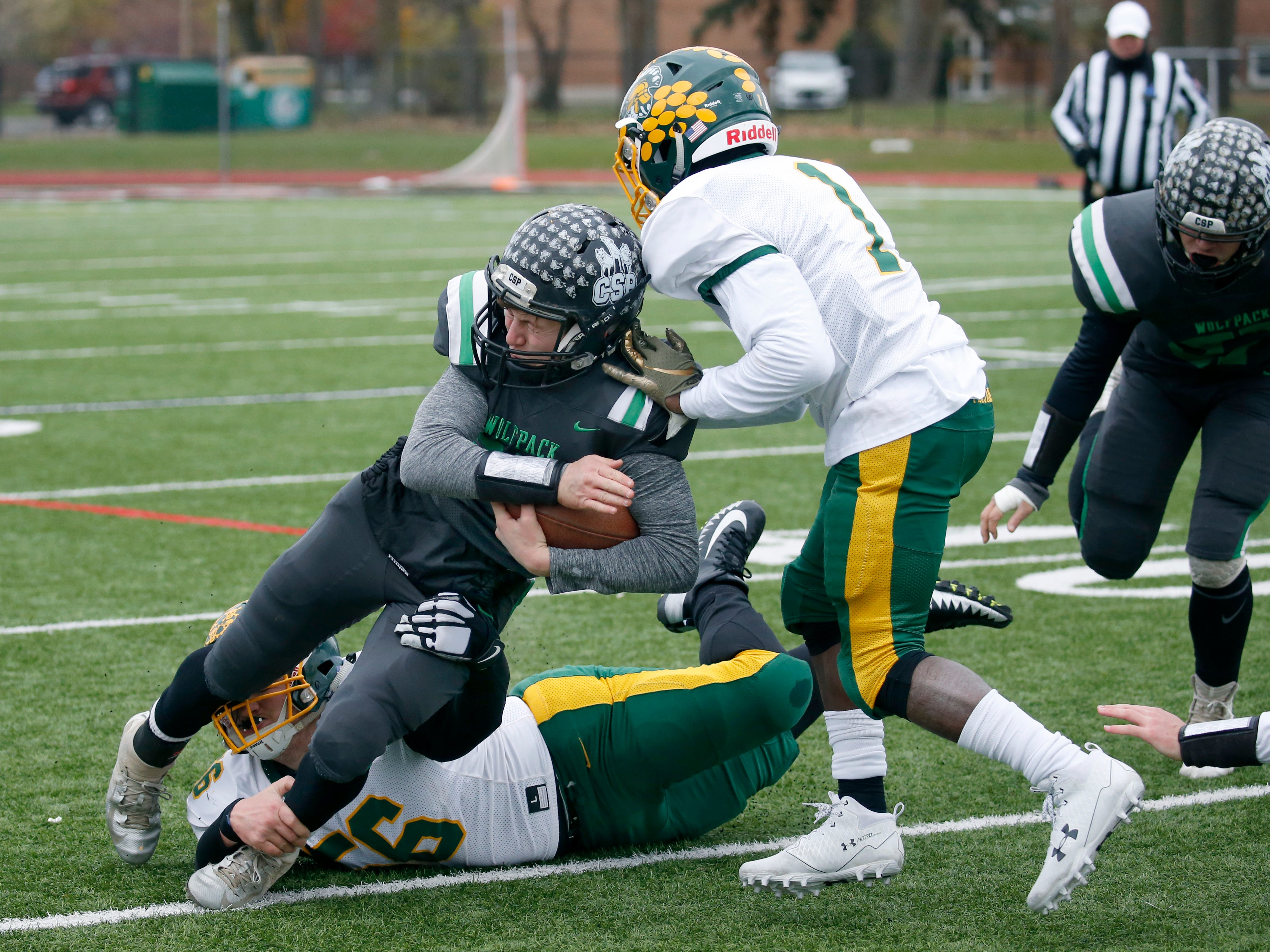 Alexander's Jake Jasen and Chris McClinic tackle Clymer-Sherman-Panama's Derek Ecklund in the second quarter at Clarence High School.
