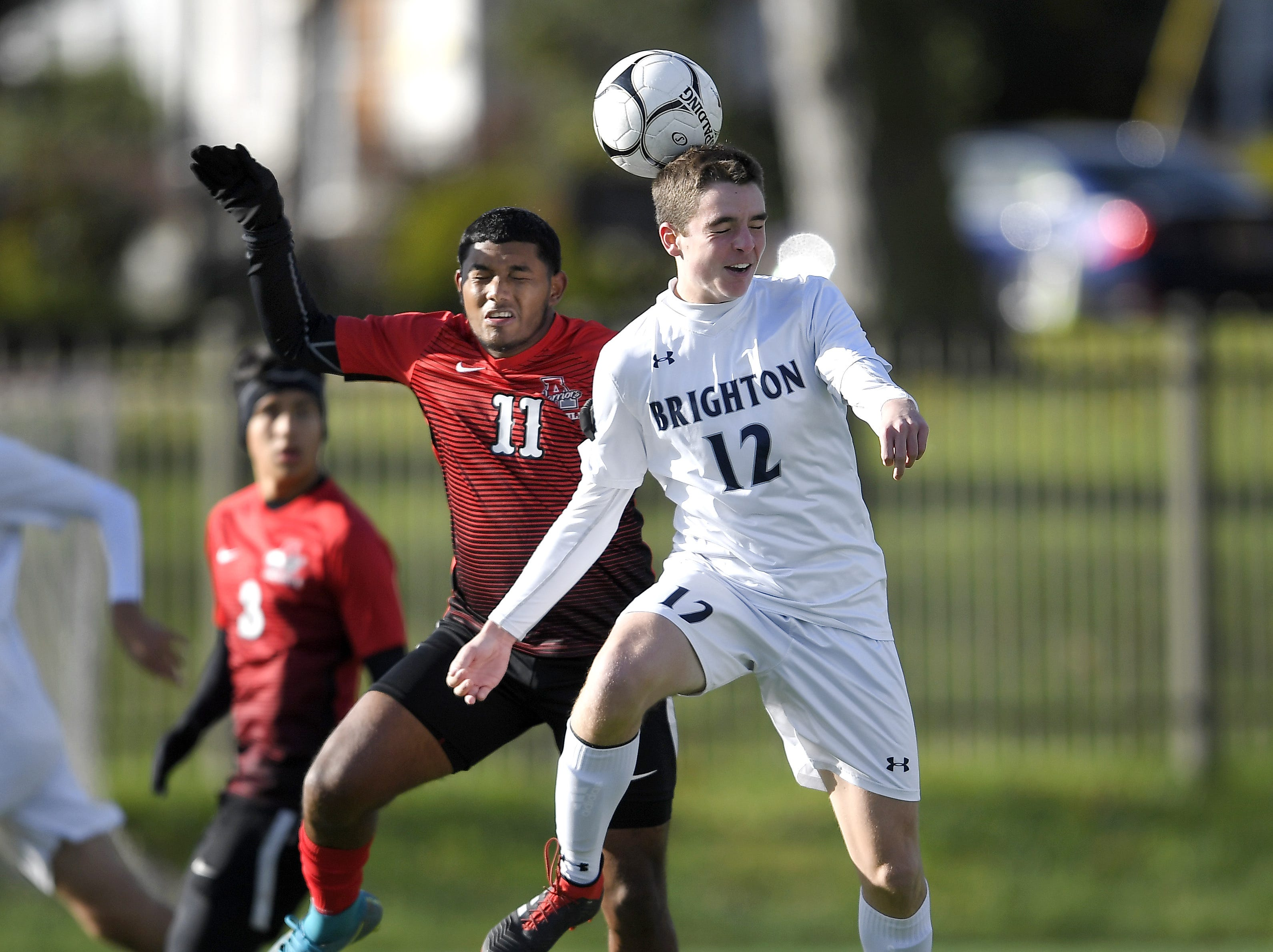 Brighton's Connor McQuillan, right, wins a header in front of Amityville's Deiby Ortega during a Class A semifinal at the NYSPHSAA Boys Soccer Championships in Newburgh, N.Y., Saturday, Nov. 10, 2018. Brighton's season ended with a 2-0 loss to Amityville-XI.