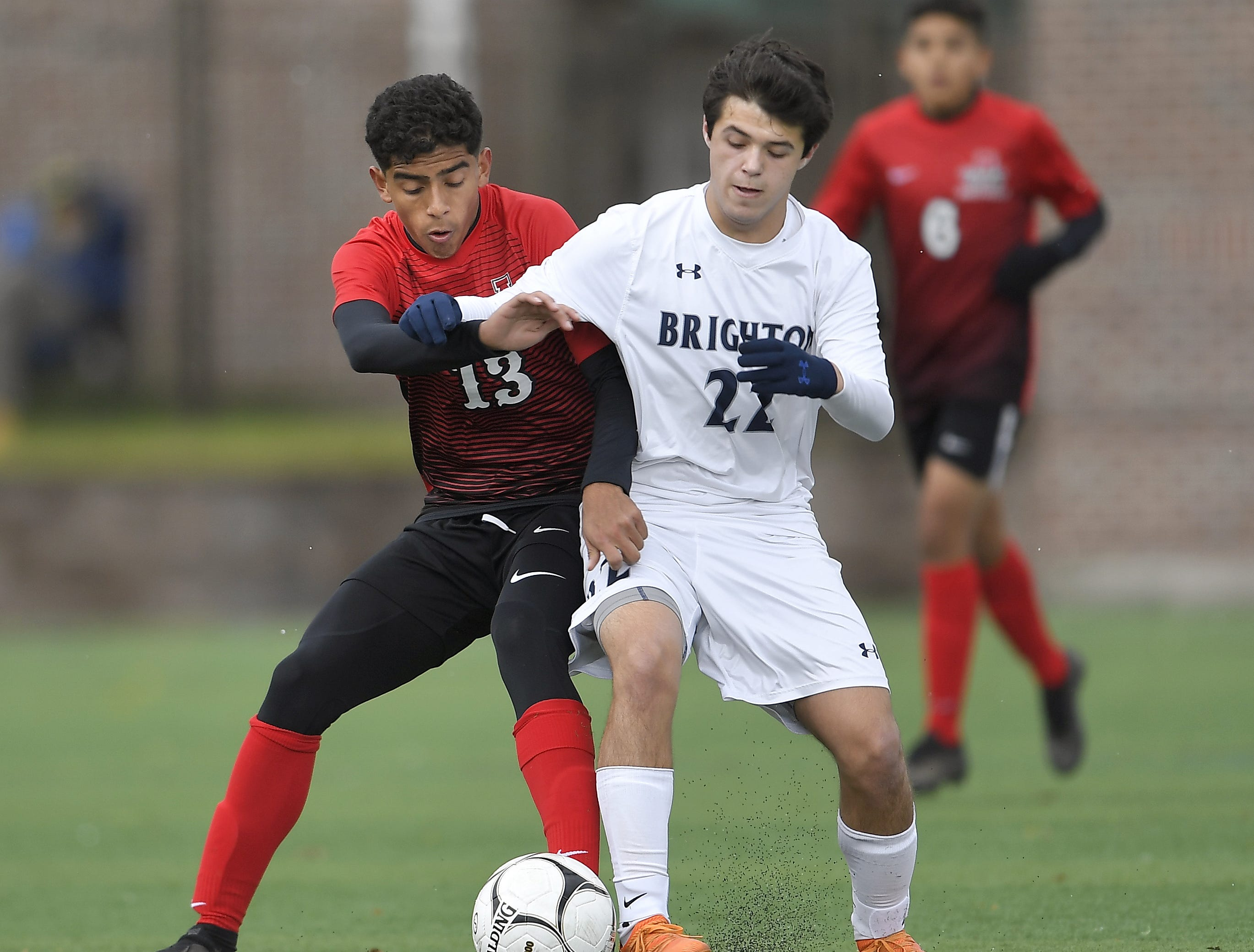 Brighton's Nico Leone, right, and Amityville's Rolman Guardado challenge for the ball during a Class A semifinal at the NYSPHSAA Boys Soccer Championships in Newburgh, N.Y., Saturday, Nov. 10, 2018.
