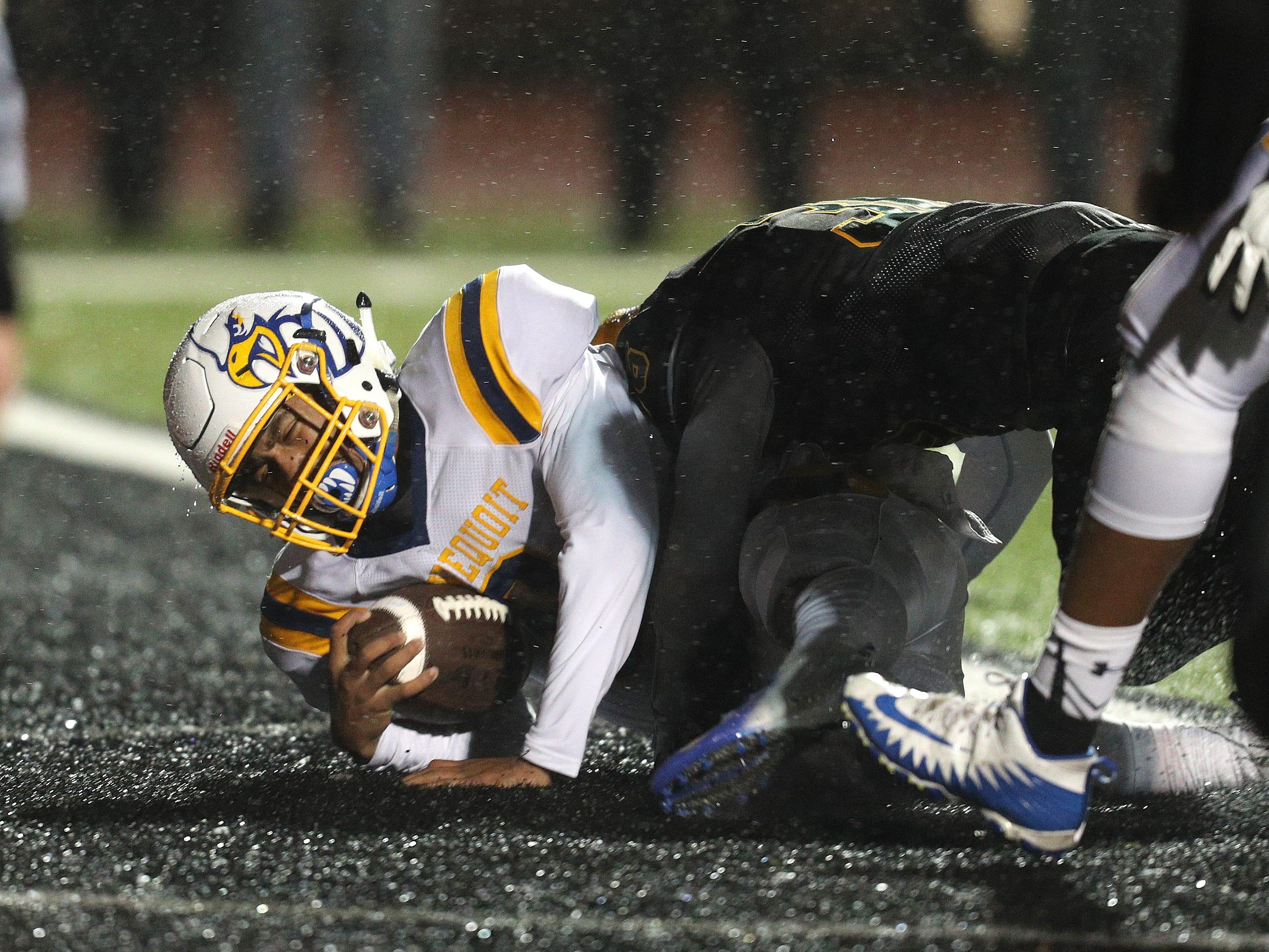 Freddy June Jr. scores a touchdown against West Seneca East in the Far West Regional  Class A game.