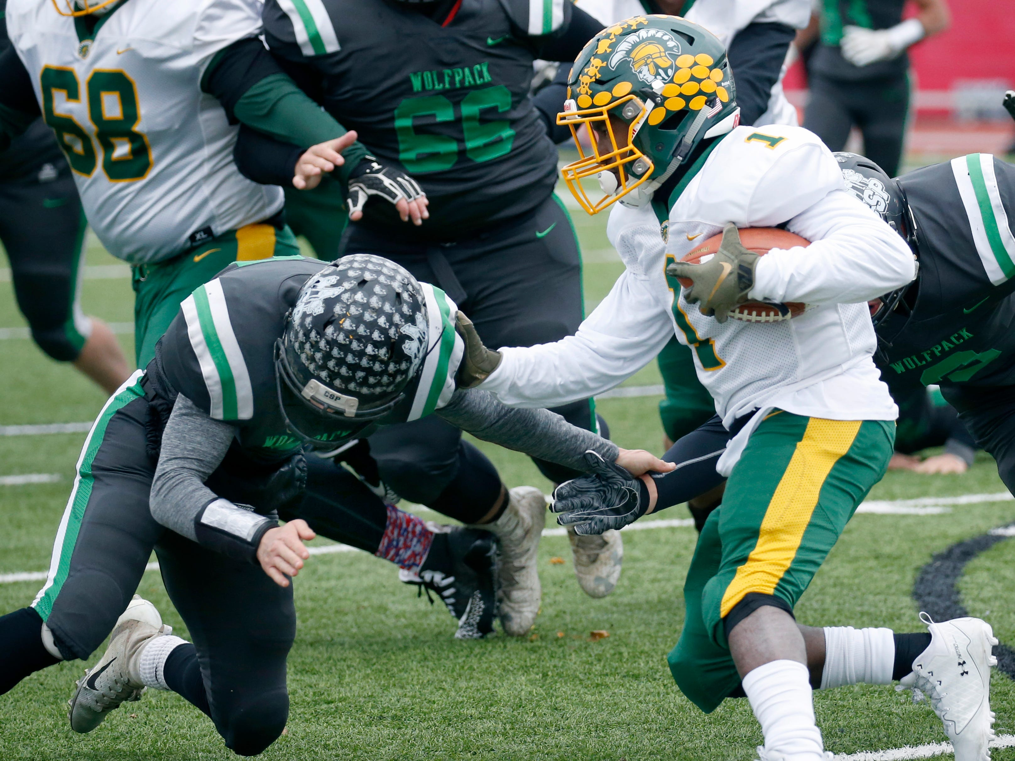 Alexander's Chris McClinic pushes away Clymer-Sherman-Panama's Derek Ecklund as he runs the ball in the second quarter at Clarence High School.