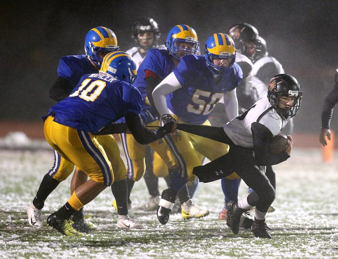 Letchworth/Warsaw's Dalton English tries to escape a tackle during the Far West Regional game against Cleveland Hill.