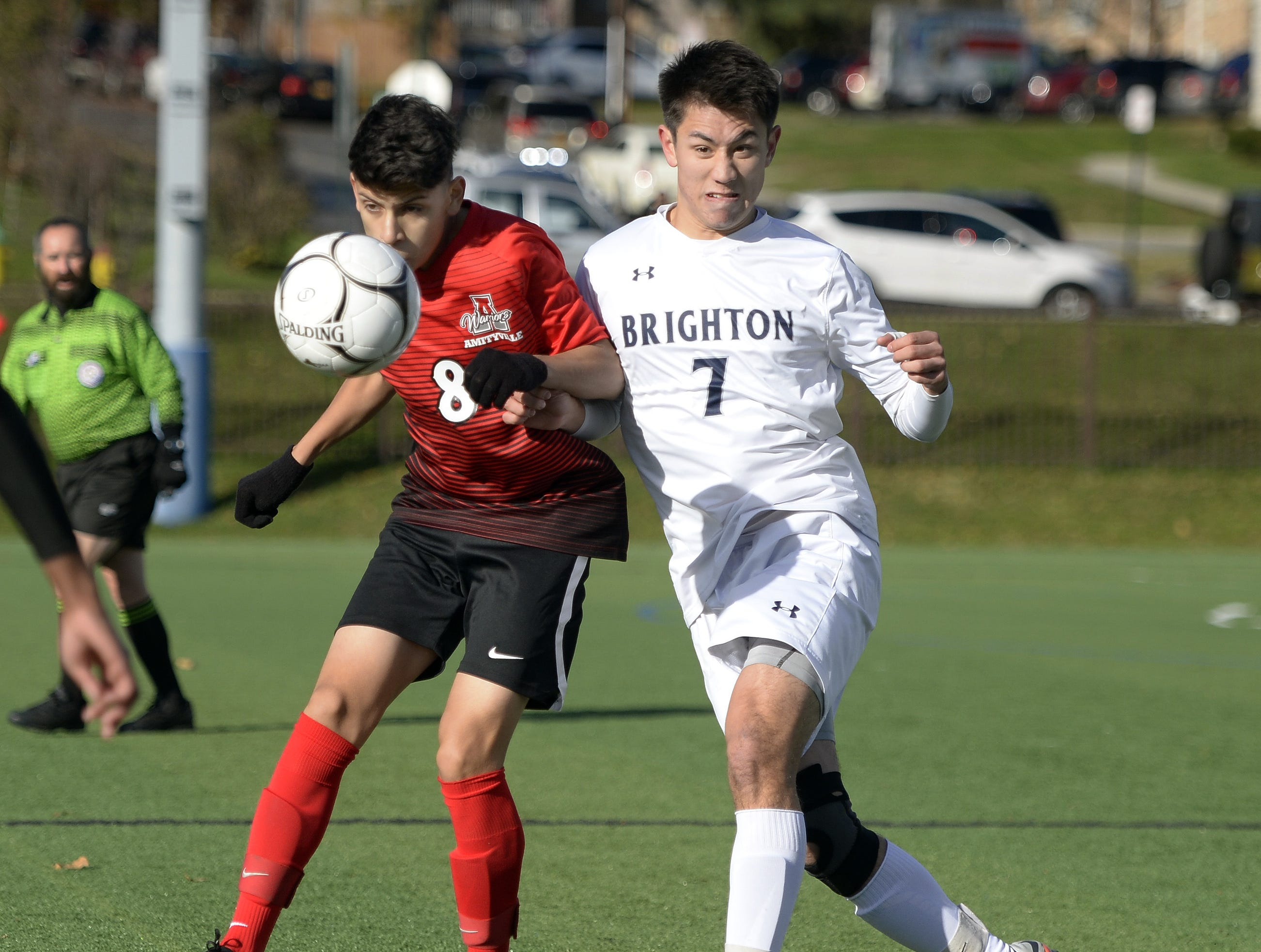Brighton's Gabriel Barraclough-Tan, right, clears the ball past Amityville's Juan Ponce during a Class A semifinal at the NYSPHSAA Boys Soccer Championships in Newburgh, N.Y., Saturday, Nov. 10, 2018.