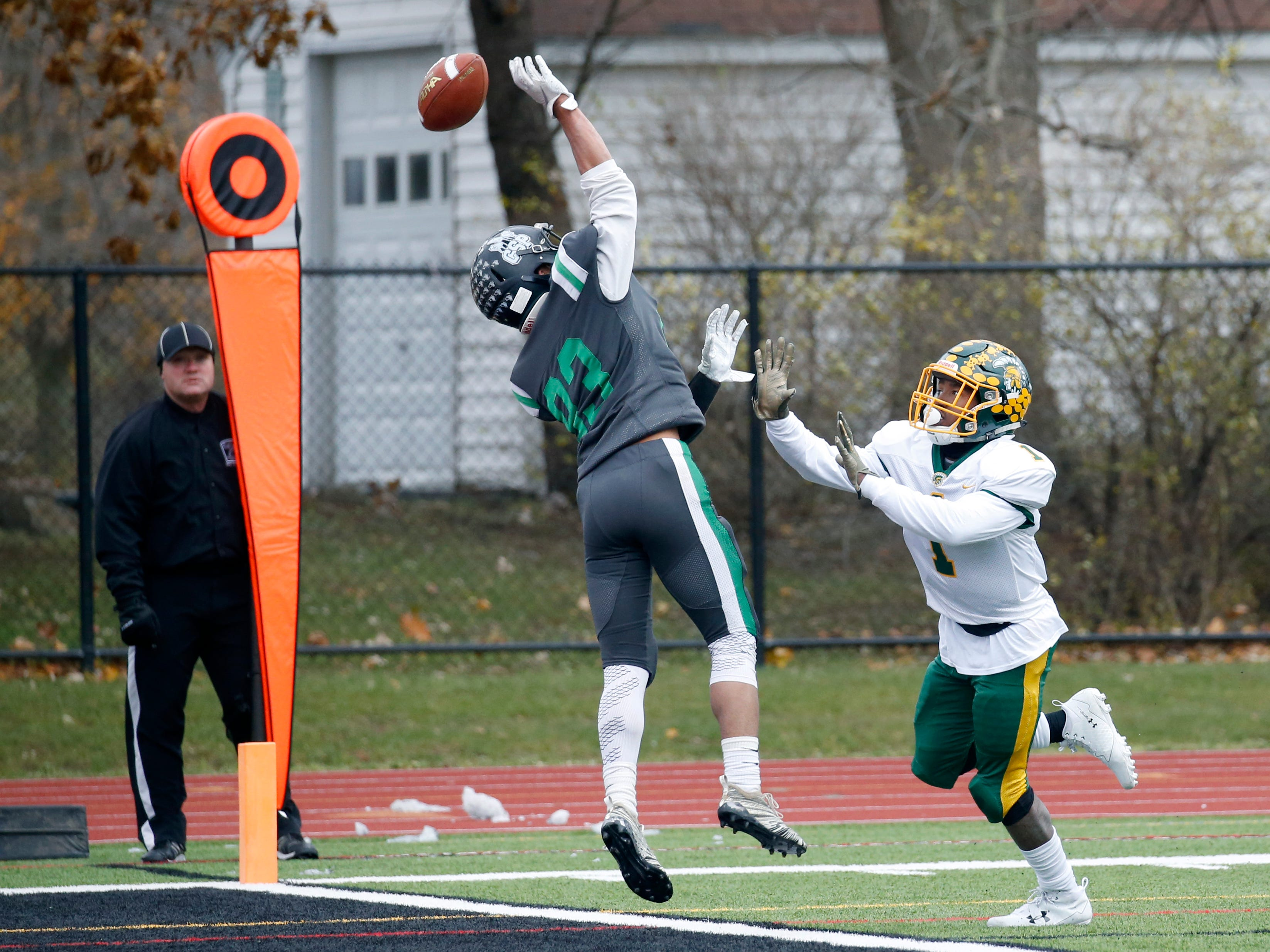 A pass intended for Alexander's Chris McClinic goes long as Clymer-Sherman-Panama's Zavon Overton tries for the interception in the second quarter at Clarence High School.