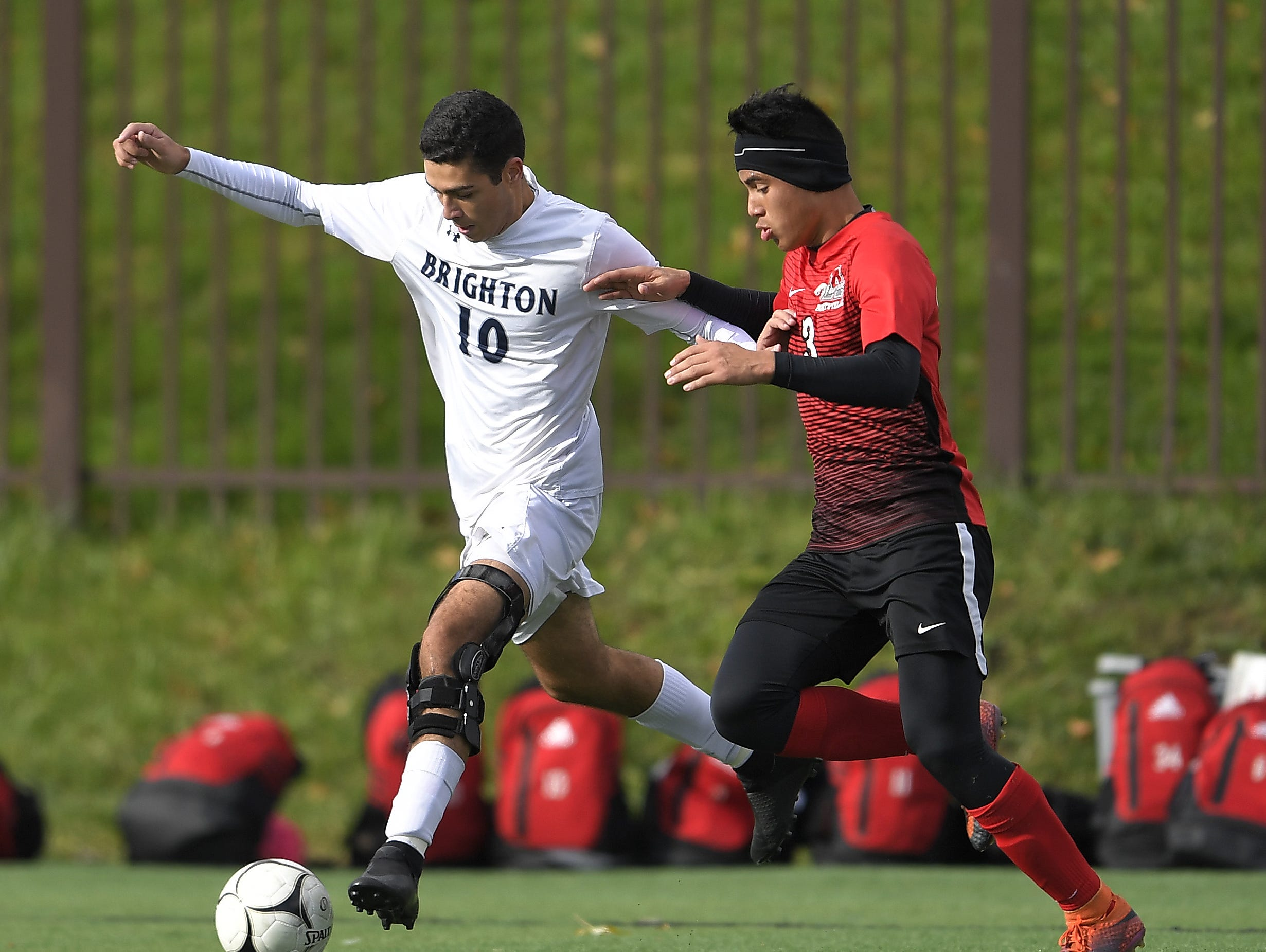 Brighton's Caio De Medeiros, left, is defended by Amityville's Angel Zavala during a Class A semifinal at the NYSPHSAA Boys Soccer Championships in Newburgh, N.Y., Saturday, Nov. 10, 2018.
